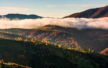 Foto Bewoelkte Berge